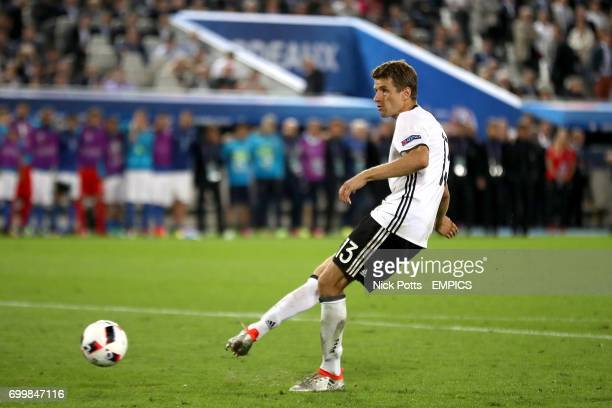 Germany's Thomas Muller sees is penalty saved by Italy goalkeeper Gianluigi Buffon in the shootout