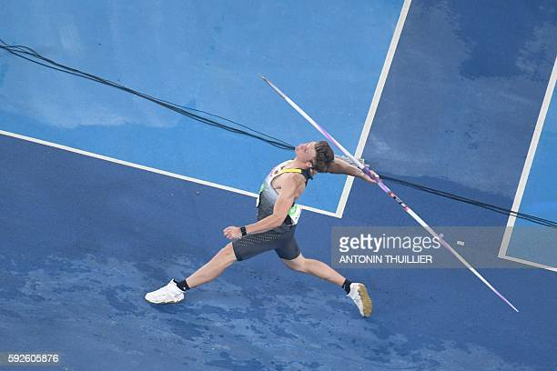 Germany's Thomas Rohler competes to win the Men's Javelin Throw Final during the athletics event at the Rio 2016 Olympic Games at the Olympic Stadium...