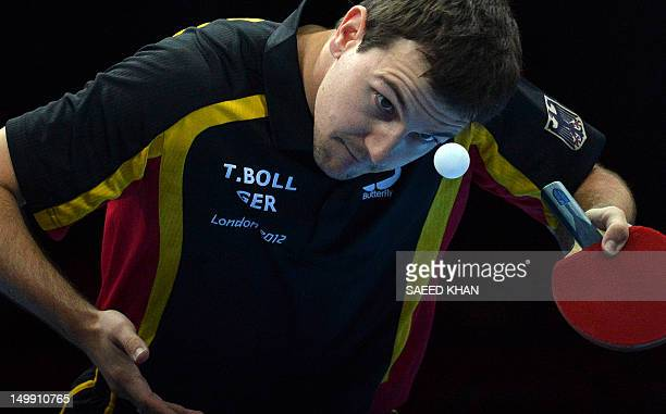 Germany's Timo Boll serves during the men's team table tennis semifinal China vs Germany of the London 2012 Olympic Games in London on August 6 2012...