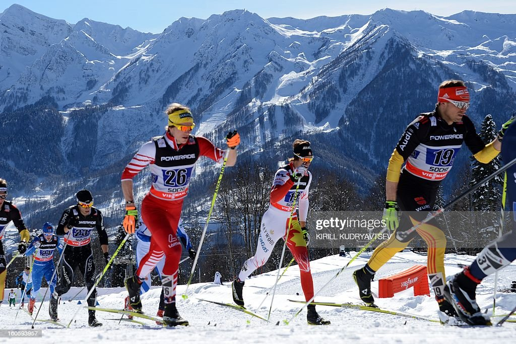 Germany's Tobias Angerer (R) competes during 6 x 1,8 km Men's Classic Team Sprint of FIS Cross Country skiing World Cup at Laura Cross Country and Biathlon Center in Russian Black Sea resort of Sochi on February 3, 2013. Russia's Maxim Vylegzhanin and Dmitry Japarov took the first place ahead of Sweden's Teodor Peterson and Emil Joensson and Germany's Axel Teichmann and Tobias Angerer.