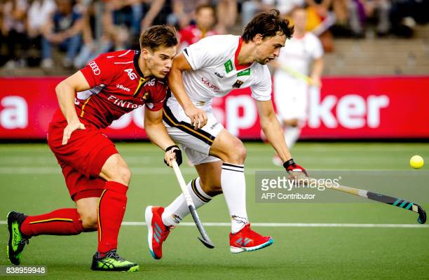 Germany's Tobias Hauke fights for the ball with Belgium's Augustin Meurmans during the men's hockey semifinal match Germany v Belgium at The Rabo...