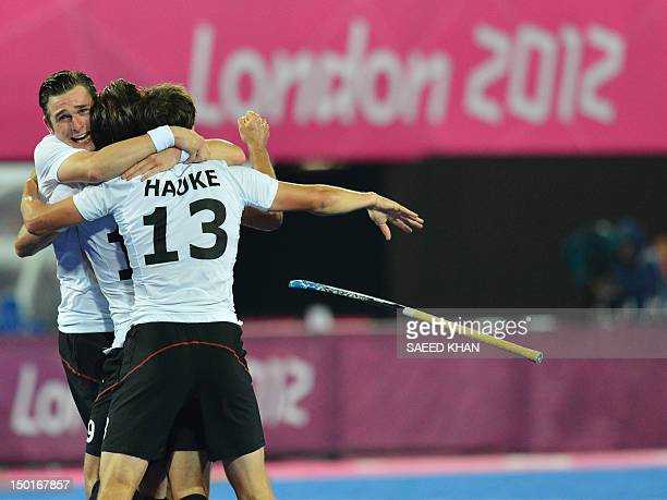 Germany's Tobias Hauke reacts after defeating the Netherlands in the men's field hockey gold medal match Germany vs the Netherlands at the London...