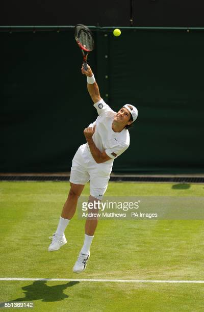 Germany's Tommy Haas in action against Russia's Dmitry Tursunov during day two of the Wimbledon Championships at The All England Lawn Tennis and...