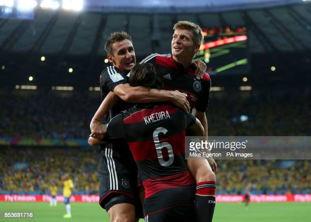 Germany's Toni Kroos celebrates scoring his side's fourth goal of the game with teammate Germany's Sami Khedira and Miroslav Klose during the FIFA...