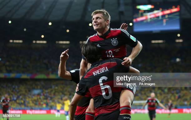Germany's Toni Kroos celebrates scoring his side's fourth goal of the game with teammate Germany's Sami Khedira during the FIFA World Cup Semi Final...