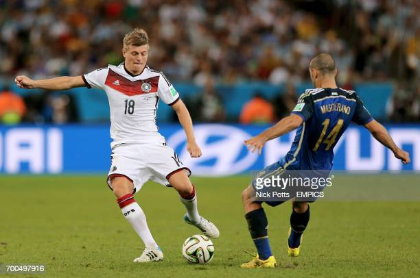 Germany's Toni Kroos in action with Argentina's Javier Mascherano