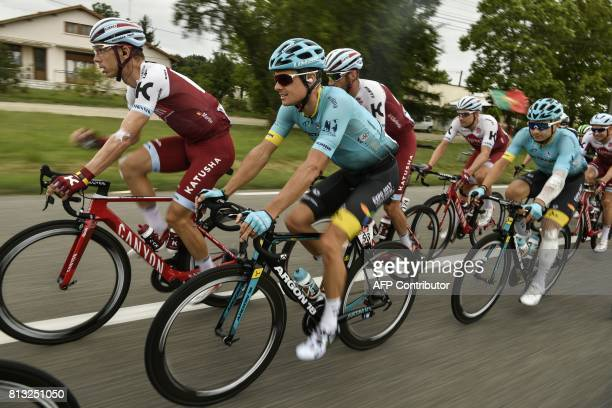 Germany's Tony Martin and Denmark's Jakob Fuglsang ride in the pack during the 2035km eleventh stage of the 104th edition of the Tour de France...