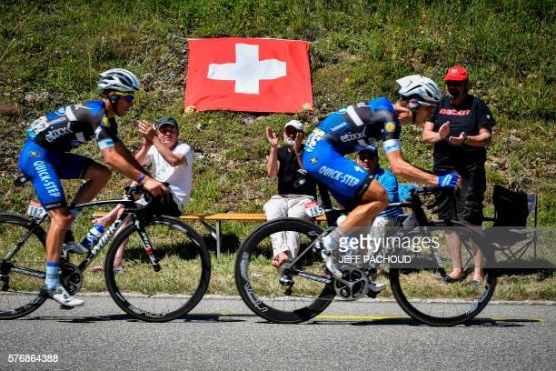Germany's Tony Martin and France's Julian Alaphilippe ride in a breakaway past Swiss fans next to a Switzerland's national flag during the 209 km...