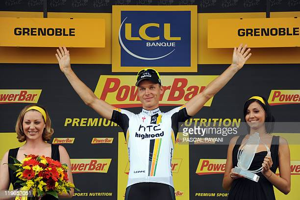 Germany's Tony Martin celebrates on the podium after winning the 425 km individual timetrial and twentieth stage of the 2011 Tour de France cycling...
