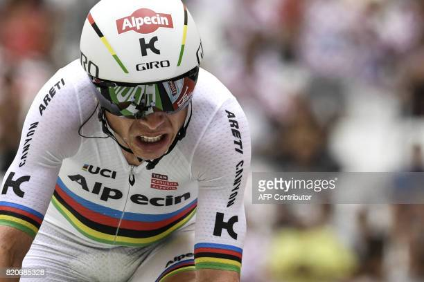 Germany's Tony Martin crosses the finish line at the Velodrome stadium at the end of a 225 km individual timetrial the twentieth stage of the 104th...