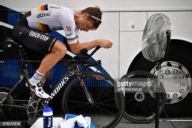 TOPSHOT Germany's Tony Martin trains in front of a standing fan prior to the 17 km individual timetrial the eighteenth stage of the 103rd edition of...