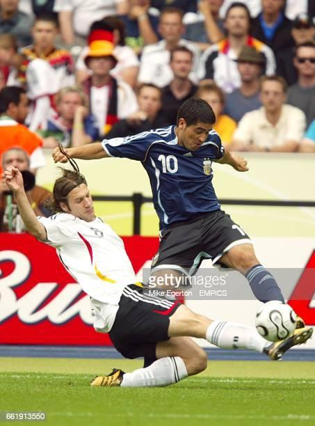 Germany's Torsten Frings slides in to tackle Argentina's Juan Riquelme