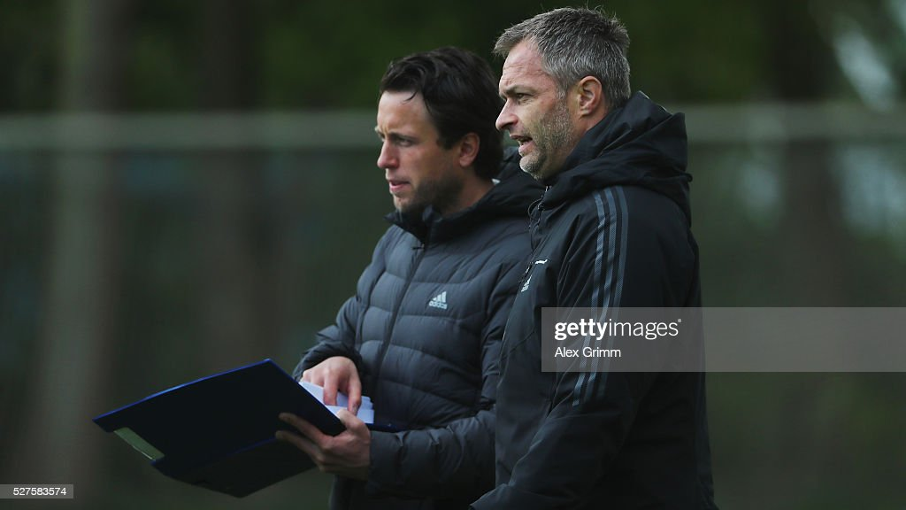 Germany's U16 coach Christian Wueck (front) and his assistant Dennis Lamby watch a match during the U16 Juniors Federal Cup at Sportschule Wedau on May 03, 2016 in Duisburg, North Rhine-Westphalia.