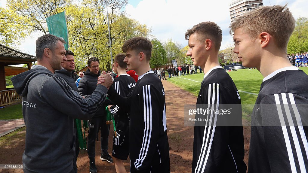 Germany's U16 coach Christian Wueck hands over the medals to the winning team of Sachsen after the U16 Juniors Federal Cup at Sportschule Wedau on May 03, 2016 in Duisburg, North Rhine-Westphalia.