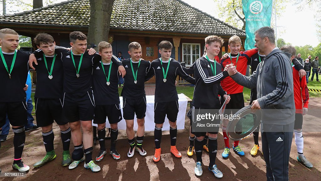 Germany's U16 coach <a gi-track='captionPersonalityLinkClicked' href=/galleries/search?phrase=Christian+Wueck&family=editorial&specificpeople=5445226 ng-click='$event.stopPropagation()'>Christian Wueck</a> hands over the trophy to the winning team of Sachsen after the U16 Juniors Federal Cup at Sportschule Wedau on May 03, 2016 in Duisburg, North Rhine-Westphalia.