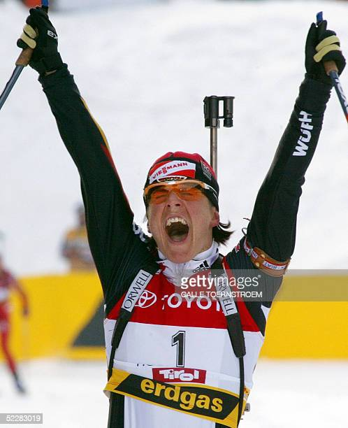 Germany's Uschi Disl celebrates her victory in the finish of the women's 10 km Pursuit during the IBU Biathlon World championships in Hochfilzen 06...
