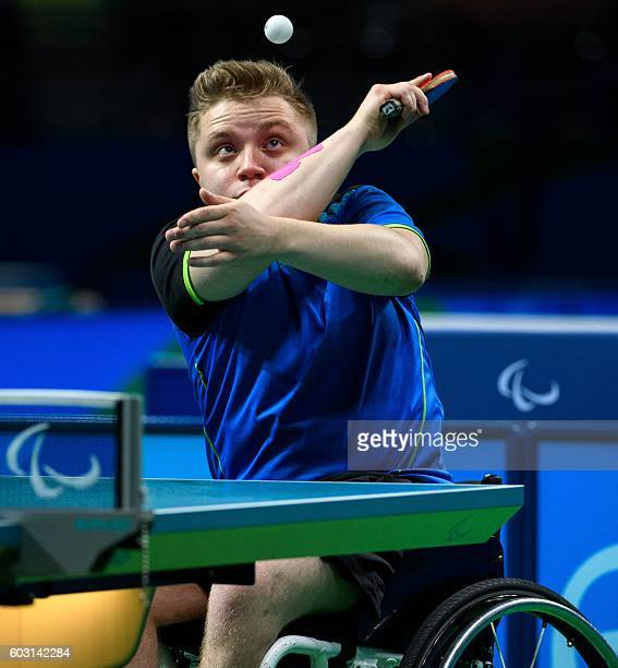 Germany's Valentin Baus plays against China's Ningning Cao in their Men's Singles Class 5 Gold Medal table tennis match during the Paralympic Games...