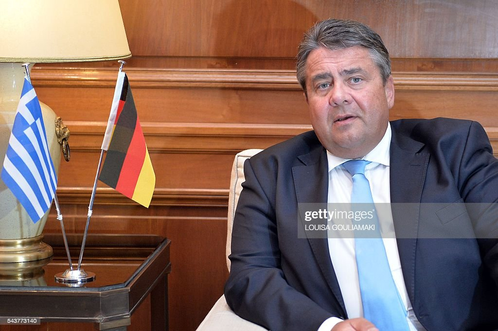 Germany's vice chancellor and economy minister Sigmar Gabriel looks on during his meeting with Greece's Prime Minister in Athens on June 30, 2016. / AFP / LOUISA