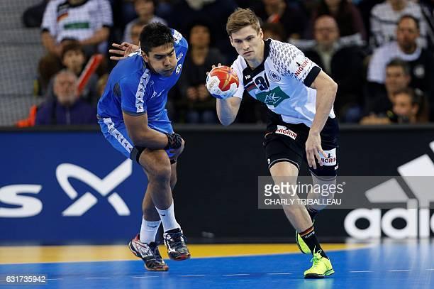 Germany's wing Rune Dahmke works around Chile's pivot Javier Frelijj during the 25th IHF Men's World Championship 2017 Group C handball match Chile...