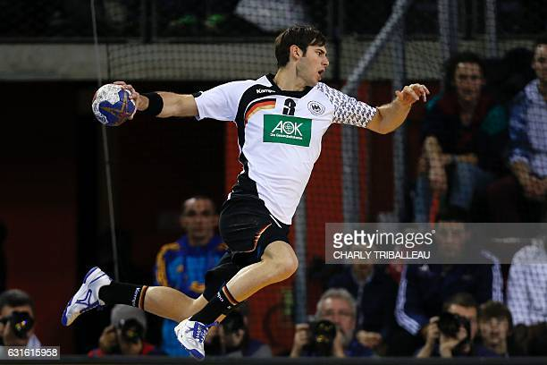 Germany's wing Uwe Gensheimer jumps to shoot during the 25th IHF Men's World Championship 2017 Group C handball match Germany vs Hungary on January...