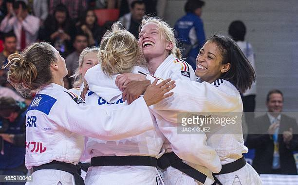 Germany's women judo team celebrates their bronze medals after the team competition at the Judo World Championships in Astana on August 30 2015 AFP...
