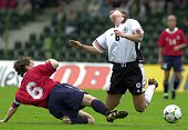 Germany's Women national soccer team player Maren Meinert is fouled by Norwegian player Hege Riise during their international 4Countries soccer...