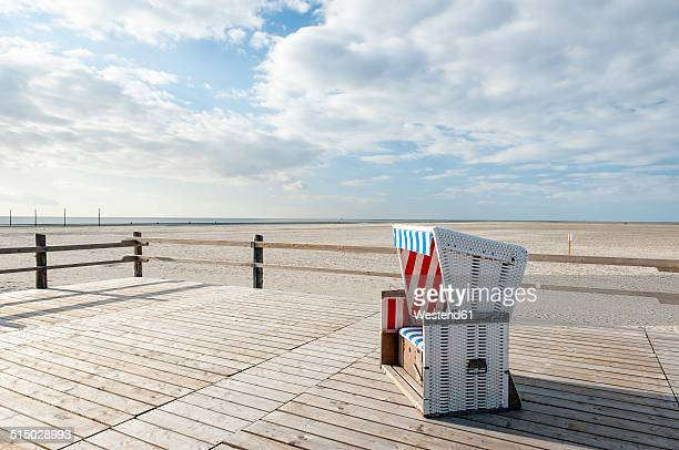 Germany,Schleswig-Holstein, North Sea, Sankt Peter-Ording, Canopied beach chair