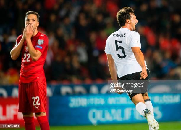Germay's defender Mats Hummels celebrates scoring next to Czech Republic´s midfielder Filip Novak during the FIFA World Cup 2018 qualification...