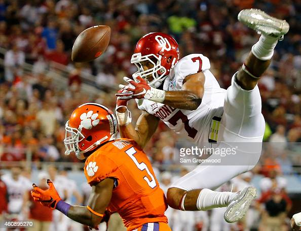 Germone Hopper of the Clemson Tigers attempts a reception against Jordan Thomas of the Oklahoma Sooners during the Russell Athletic Bowl at Florida...