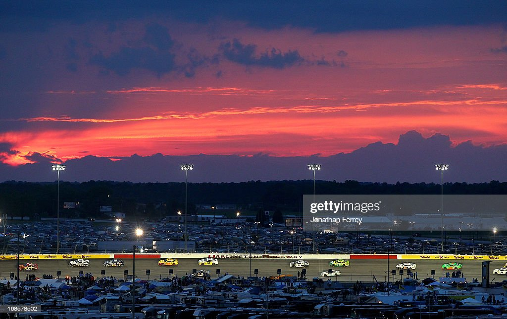 A gerneal view of the action as the suns sets during the NASCAR Sprint Cup Series Bojangles' Southern 500 at Darlington Raceway on May 11, 2013 in Darlington, South Carolina.