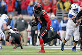 Gerod Holliman of the Louisville Cardinals runs with the ball after intercepting a pass during the game against the Kentucky Wildcats at Papa John's...