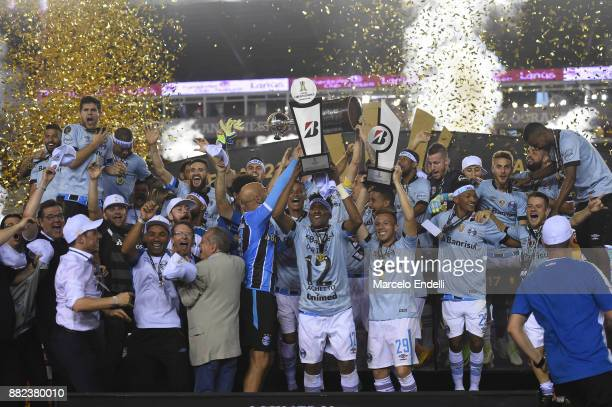 Geromel of Gremio lifts the champions trophy after the second leg match between Lanus and Gremio as part of Copa Bridgestone Libertadores 2017 Final...