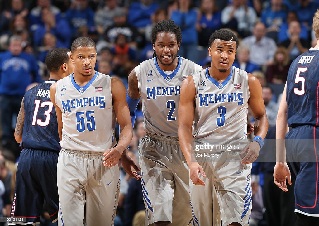 Geron Johnson #55, Shaq Goodwin #2 and Chris Crawford #3 of the Memphis Tigers look on against the Connecticut Huskies on January 16, 2014 at FedExForum in Memphis, Tennessee. Connecticut beat Memphis 83-73.