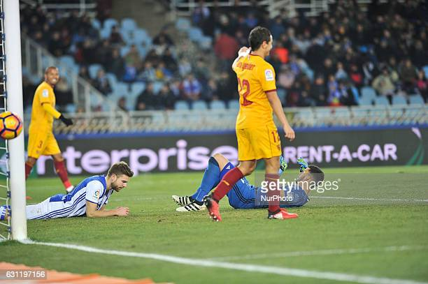 Geronimo Rulli and Illarramendi of Real Sociedad reacts during the Spanish league football match between Real Sociedad and Sevilla at the Anoeta...