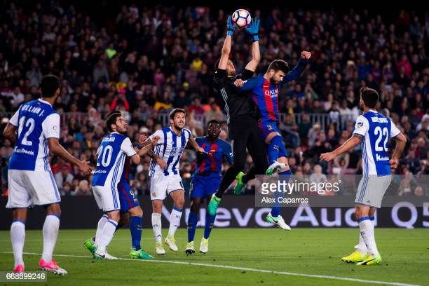 Geronimo Rulli of Real Sociedad de Futbol blocks the ball under pressure from Gerard Pique of FC Barcelona during the La Liga match between FC...