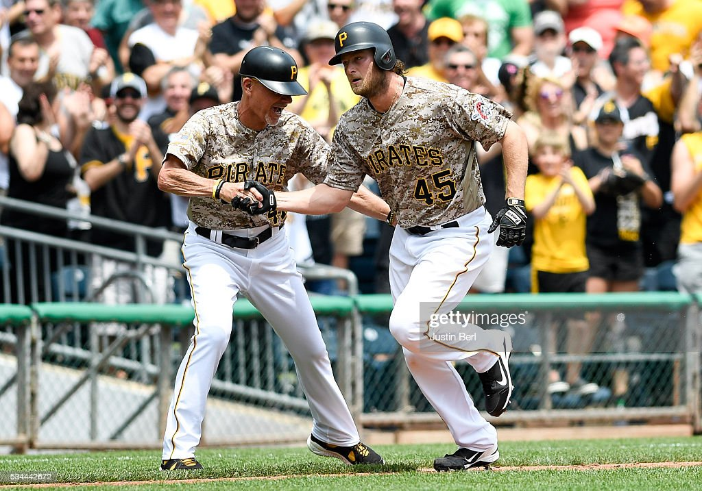 <a gi-track='captionPersonalityLinkClicked' href=/galleries/search?phrase=Gerrit+Cole&family=editorial&specificpeople=7072350 ng-click='$event.stopPropagation()'>Gerrit Cole</a> #45 of the Pittsburgh Pirates is greeted by third base coach third base coach Rick Sofield #41 after hitting a three run home run in the second inning during the game against the Arizona Diamondbacks at PNC Park on May 26, 2016 in Pittsburgh, Pennsylvania.