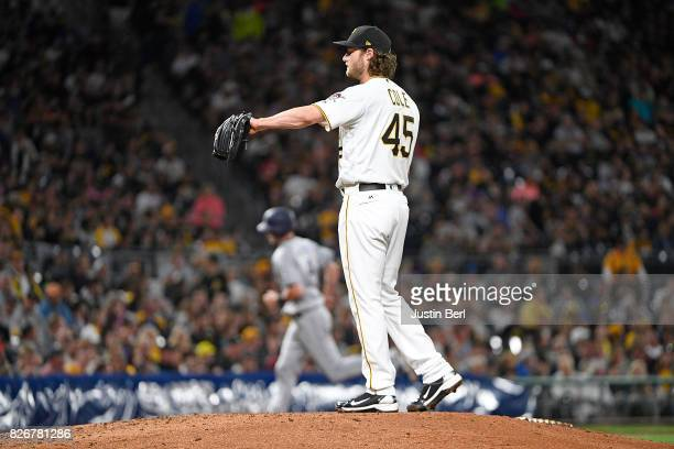 Gerrit Cole of the Pittsburgh Pirates reacts as Wil Myers of the San Diego Padres rounds the bases after hitting a two run home run in the fifth...