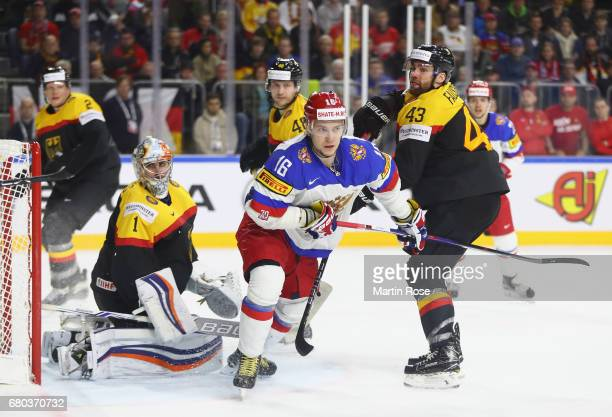 Gerrit Fauser of Germany challenges Sergei Plotnikov of Russia during the 2017 IIHF Ice Hockey World Championship game between Germany and Russia at...