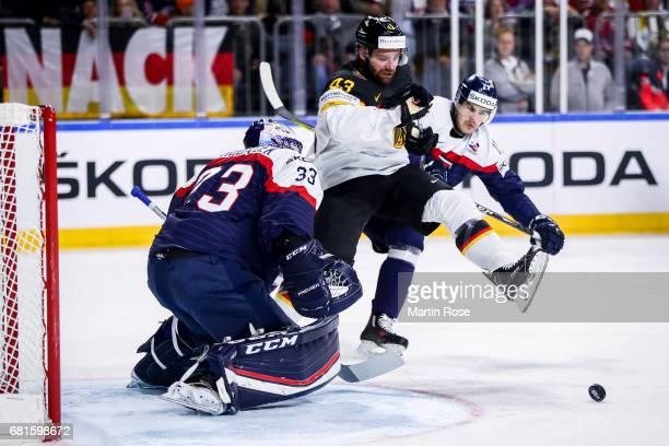 Gerrit Fauser of Germany tries to score agains Julius Hudacek goalkeeper of Slovakia during the 2017 IIHF Ice Hockey World Championship game between...