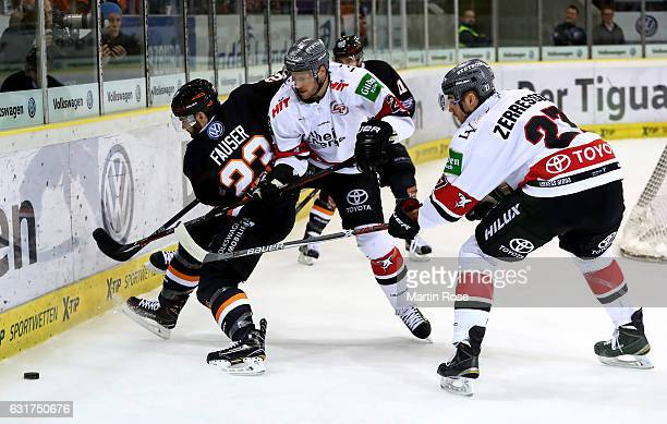 Gerrit Fauser of Wolfsburg and Corey Potter of Koeln battle for the puck during the DEL match between Grizzly Wolfsburg and Koelner Haie at BraWo Ice...