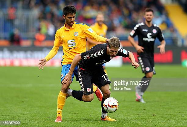 Gerrit Holtmann of Braunschweig challenges for the ball with Daniel Buballa of St Pauli during the Second Bundesliga match between Eintracht...