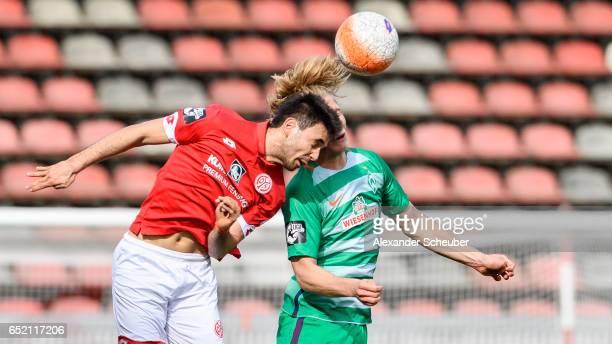 Gerrit Holtmann of Mainz challenges Jesper Verlaat of Bremen during the Third League match between Mainz 05 II and SV Werder Bremen II at Bruchweg...