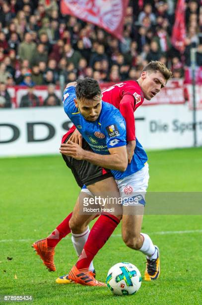 Gerrit Holtmann of Mainz vies with Pascal Stenzel of Freiburg during the Bundesliga match between SportClub Freiburg and 1 FSV Mainz 05 at...