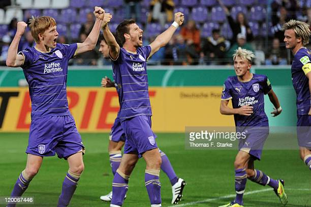 Gerrit Wegkamp and Jan Mauersberger celebrate their teams second goal during the first round match of the DFB Cup between VfL Osnabrueck and TSV 1860...