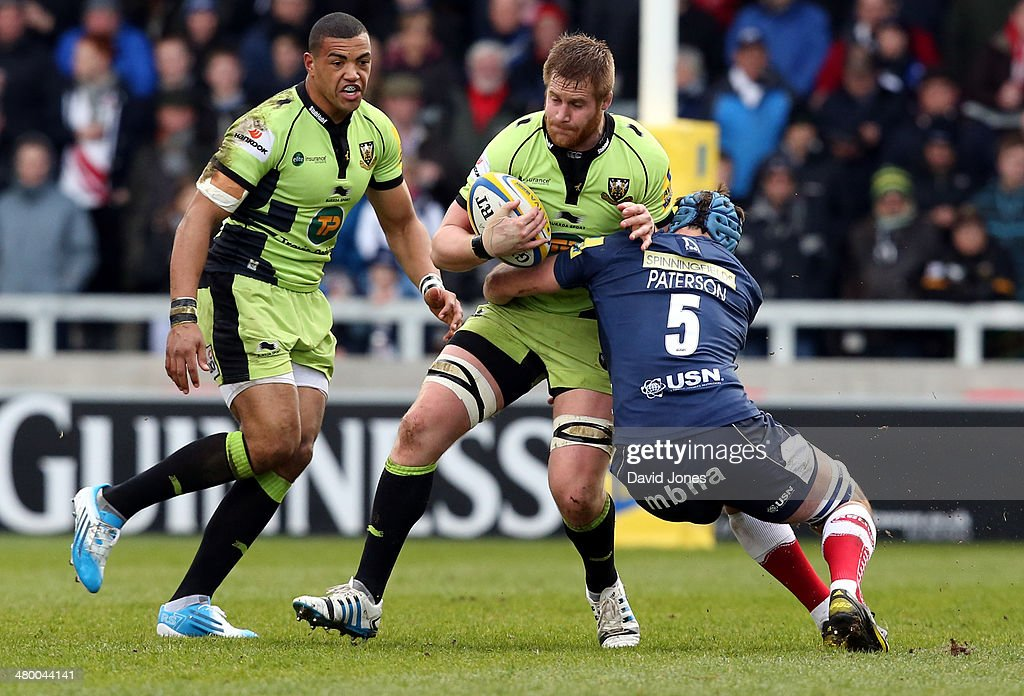 Gerrit-Jan Van Veize of Northampton Saints is tackled by Michael Paterson of Sale Sharks during the Aviva Premiership match between Sale Sharks and Northampton Saints at A J Bell Stadium on March 22, 2014 in Salford, England