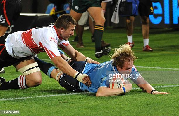 GerritJan van Velze of the Bulls scores a try despite the attentions of Derick Minnie of the Lions during the Absa Currie Cup match between Vodacom...