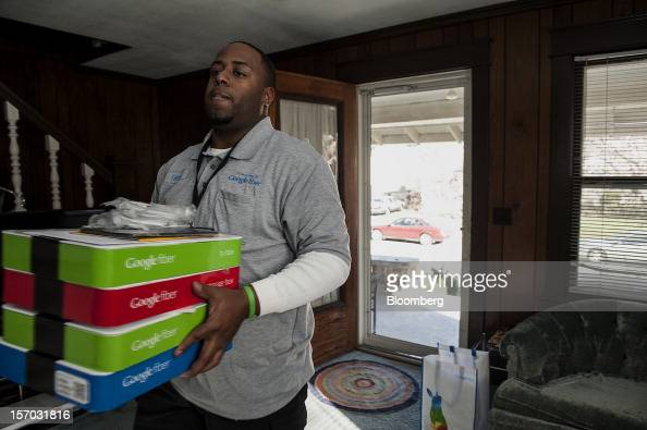 Gerron Diamond a Google Inc broadband technician carries boxes of equipment needed to install Google Fiber network at the home of customer Becki...
