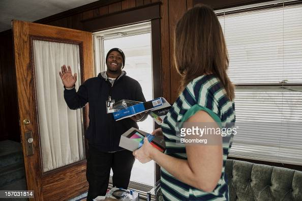 Gerron Diamond a Google Inc broadband technician left waves while arriving to install Google Fiber network at the home of customer Becki Sherwood in...