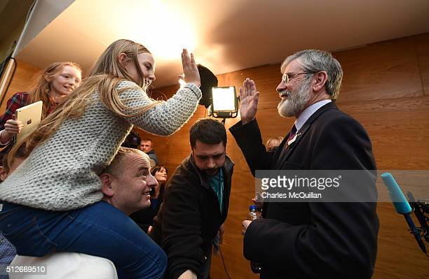 Gerry Adams of Sinn Fein is high fived by a young supporter at the Irish General Election constituency count on February 27 2016 in Dundalk Ireland...