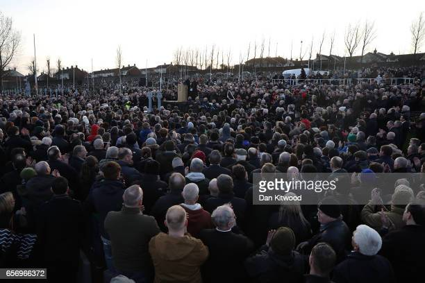 Gerry Adams speaks during Martin McGuinness' Funeral at the Derry City Cemetery on March 23 2017 in Londonderry Northern Ireland The funeral is held...
